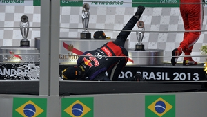 Red Bull driver Mark Webber takes a tumble after his last F1 Grand Prix in Brazil