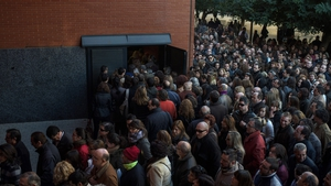 Some of the 34,797 people who applied for 200 jobs in health services turn up for the entrance exam at the University of Valencia