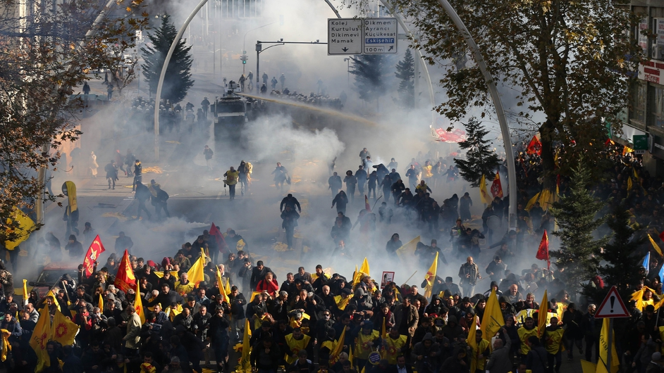 Turkish police fire tear gas and water cannon during a demonstration called by teachers' unions in Ankara