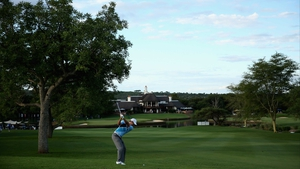 Charl Schwartzel plays his second shot at the 18th