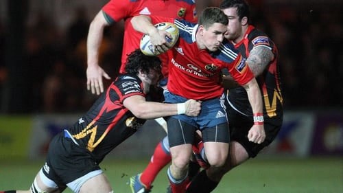 Munster's Ian Keatley struggles to escape from Cory Hill and Owen Evans