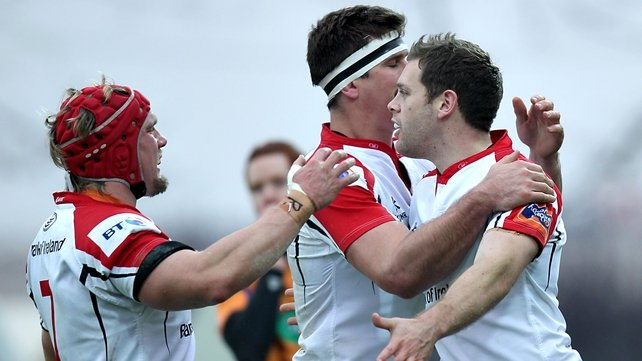 Darren Cave (r) celebrates his first-half try with some team-mates