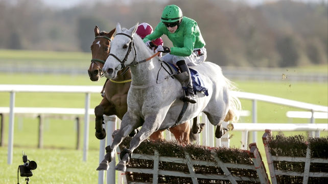 Pink Coat jumps the last hurdle in the Bar One Racing Handicap Hurdle at Fairyhouse