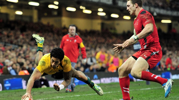 Wallabies wing Joe Tomane dives over to score a vital try