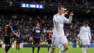 Gareth Bale celebrates after scoring Real's fourth and completing his hat-trick
