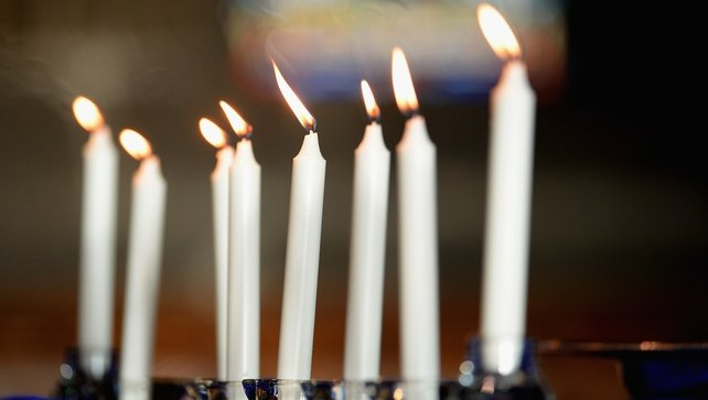 Eight candles were lit during the service in memory of the eight people who died in the crash