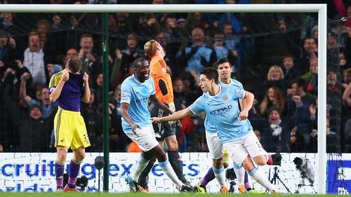 Samir Nasri (r) celebrates City's second goal with Yaya Toure
