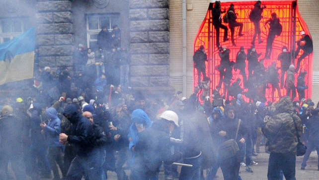 Protesters fired flares at police who threw them back and shot stun grenades into the crowd