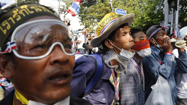 Protesters face off with police as they battle to occupy Government House