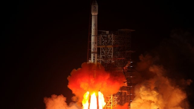 The Chang'e-3 rocket carrying the Jade Rabbit rover blasts off