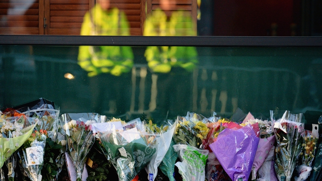 Flowers left near the crash site in Glasgow