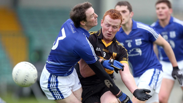 Johnny Buckley of Dr Crokes and Cratloe's Barry Duggan jostle for possession