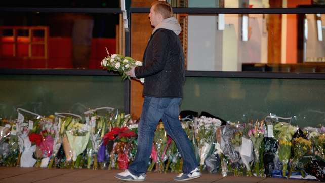 Celtic manager Neil Lennon lays a wreath near The Clutha bar