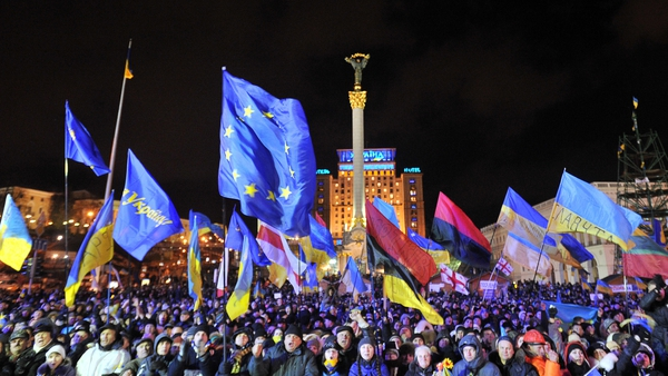 People shout slogans and wave Ukrainian and European Union flags during an opposition rally at Independence Square in Kiev