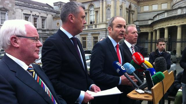 Former Labour deputy Colm Keaveney alongside Fianna Fáil leader Micheál Martin outside Leinster House