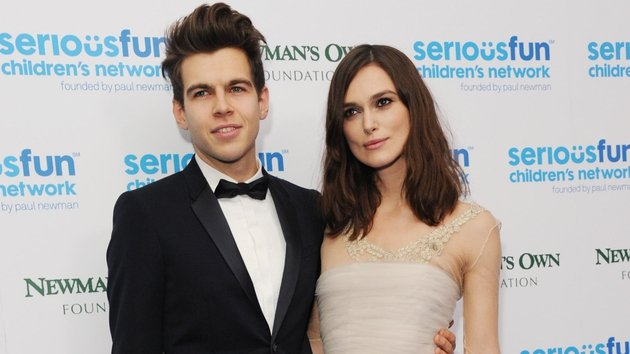 Keira Knightley recycles her wedding dress for charity gala, pictured with husband James Righton