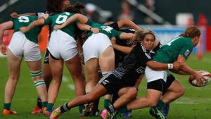 Amy Davis of Ireland is tackled by Huriana Manuel of New Zealand during the Dubai Sevens match