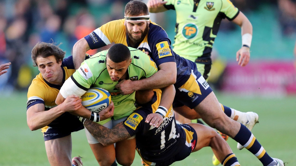 Luther Burrell of Northampton Saints is tackled by during the Aviva Premiership match against Worcester