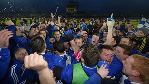 Ballinderry players and supporters celebrate winning the Ulster club football title