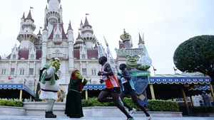 Participants run through Universal Studios Singapore during the Singapore Standard Chartered Marathon