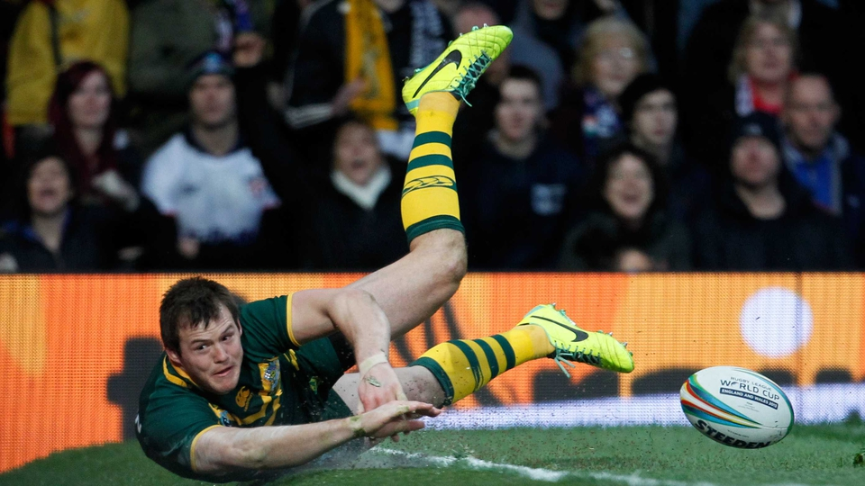 Brett Morris of Australia slides off the field of play after scoring a try during the Rugby League World Cup final against Australia at Old Trafford