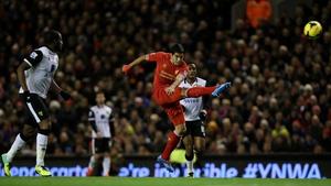 Luis Suarez scores his long-range first