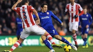 Cardiff's Peter Whittingham has a shot blocked by Erik Pieters of Stoke