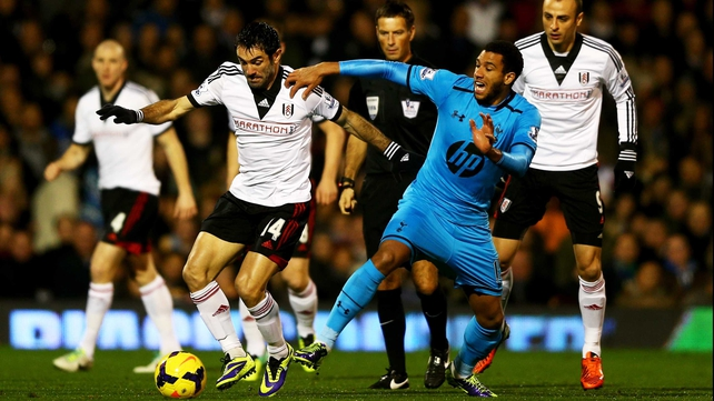 Giorgos Karagounis of Fulham holds off Etienne Capoue of Tottenham