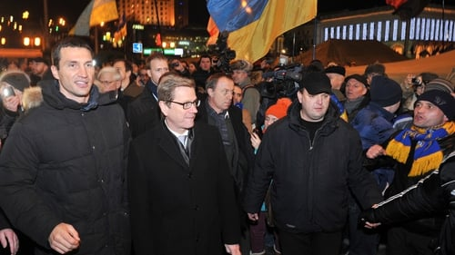 German Foreign Minister Guido Westerwelle (centre) visits anti-government protests in Kiev with Ukrainian boxing champion Wladimir Klitschko (L)