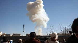 Yemenis look on as smoke rises from the site of a suicide car bombing at the defence ministry in the Yemeni capital Sanaa