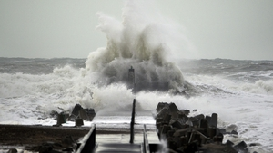 Waves hit the coast of Northern Jutland in Denmark as storms lash Britain and northern Europe
