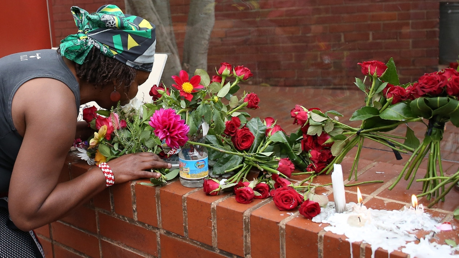 Flowers and candles are placed at a makeshift shrine in Soweto