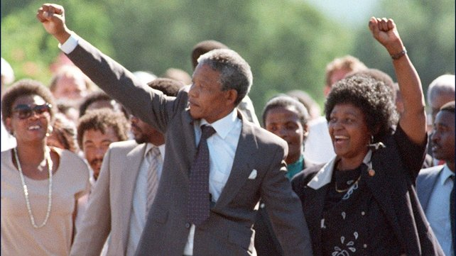 Nelson Mandela and then wife Winnie raise their fists upon his release from prison on 11 February 1990