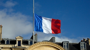 The French national flag flies at half mast on the Elysee presidential palace in tribute to the late Nelson Mandela