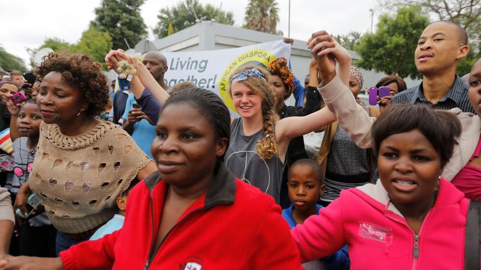 People gather outside Mr Mandela's home