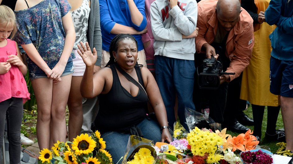 A woman expresses her grief at a makeshift shrine in Johannesburg