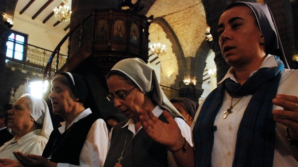 Nuns attend a prayer vigil for peace at the Lady of Dormition, the Melkite Greek Catholic patriarchal cathedral in the Old City of Damascus