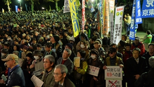 Demonstrators rally over Japanese state secrets bill which is aimed at toughening penalties for leaks gathered outside the Japanese parliament
