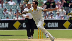 Mitchell Johnson celebrates his wicket of England's Stuart Broad