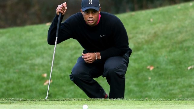 Tiger Woods lines up a putt at the World Challenge invitational