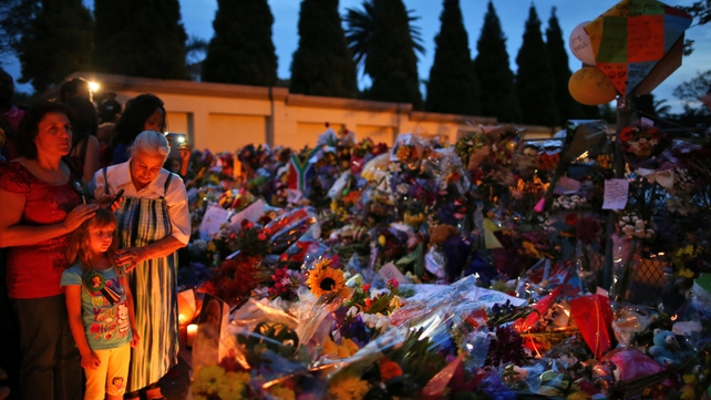 Floral tributes laid outside the Houghton home of Nelson Mandela