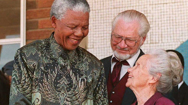 South African President Nelson Mandela shakes hands with wife of the architect of apartheid prime minister H F Verwoerd