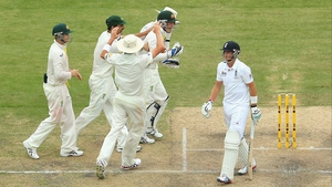 Joe Root walks after being caught out