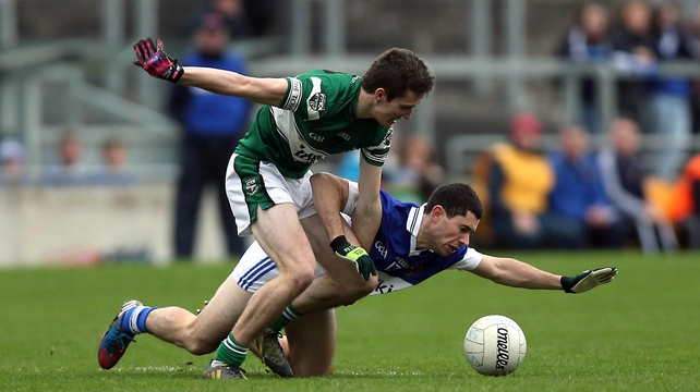 David Seale of Portlaoise (l) battles with Ruairi Trainor of St Vincent's