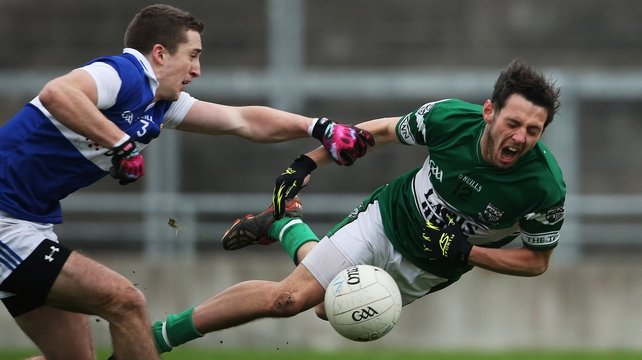 Portlaoise's Craig Rogers (r) is tackled by St Vincent's Jarlath Curley