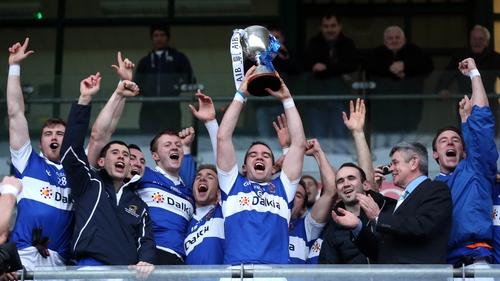 St Vincent's captain Ger Brennan lifts the trophy