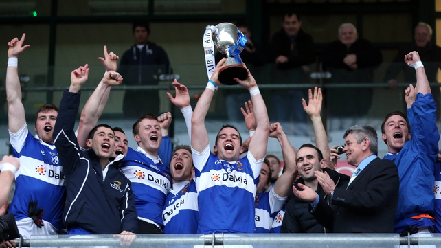 St Vincent's captain Ger Brennan lifts the trophy