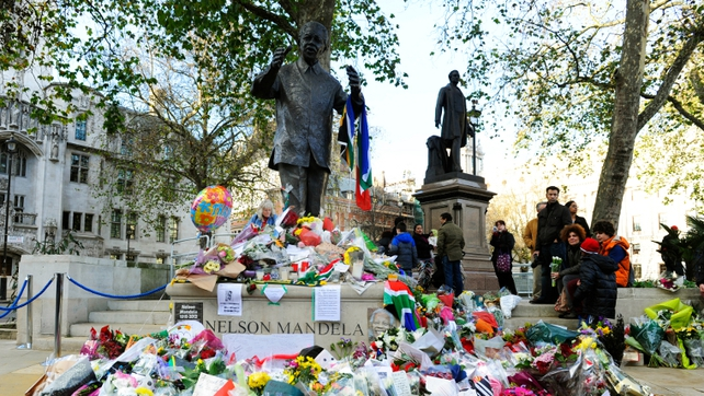 Flowers left at statue of Nelson Mandela in London