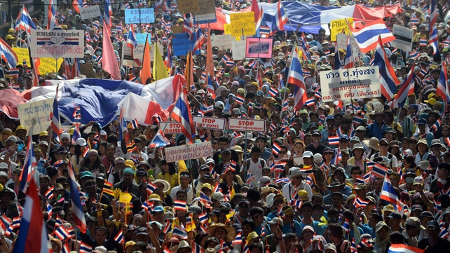 Protesters march to Government House in Bangkok