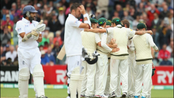 Australia celebrate victory in front of a disconsolate Monty Panesar and James Anderson